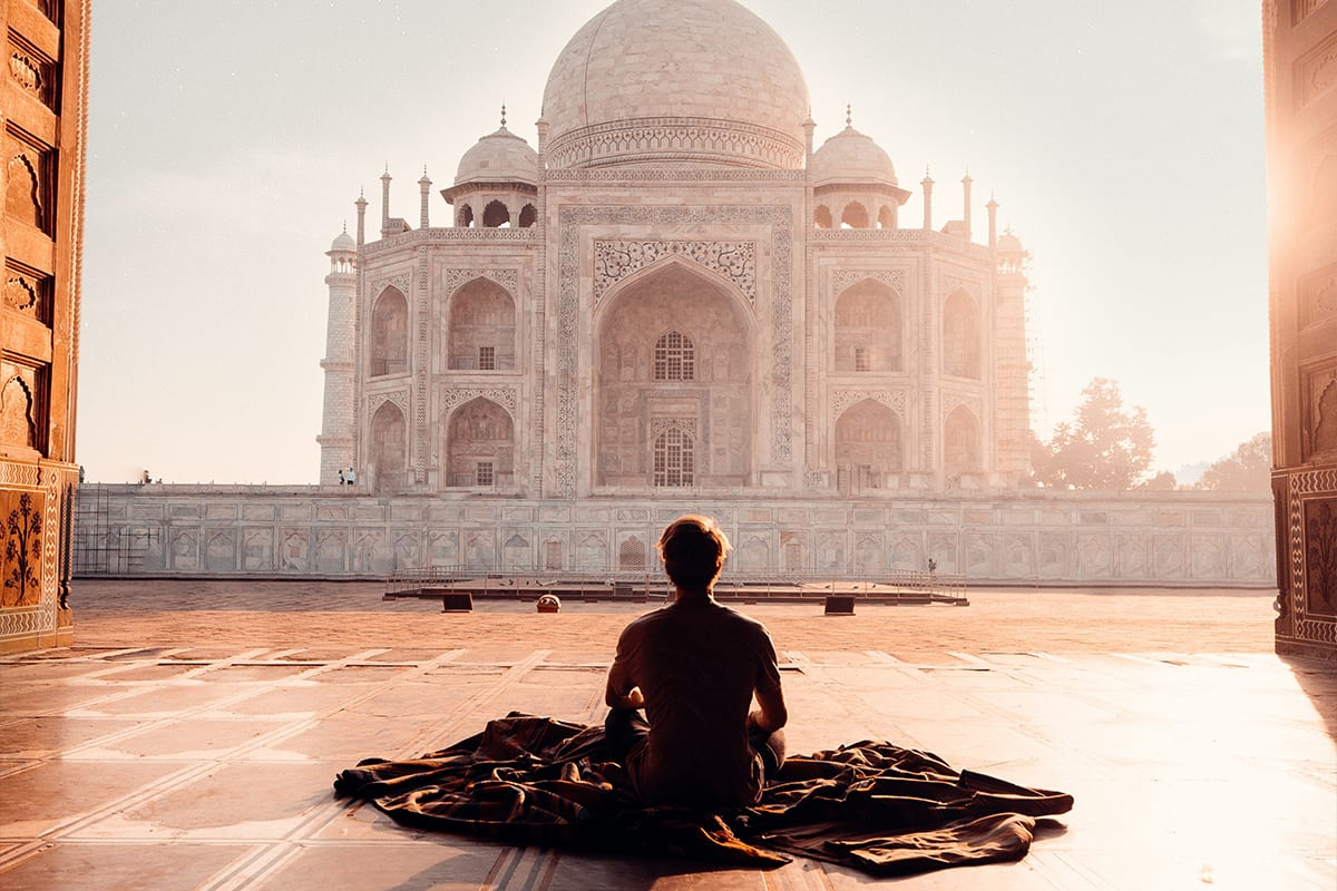 Man meditating at the Taj Mahal