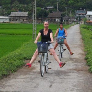 Bianca and her teammate riding bicycles