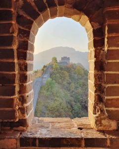 View of the Great Wall through a window in the tower. Alexia on a Great Wall of China Challenge for MS Australia