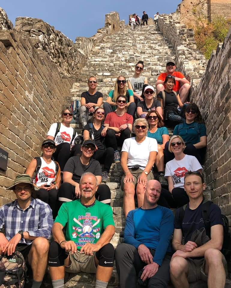 Team MS Australia group photo, sitting on the sets of the Great Wall. Alexia's story.