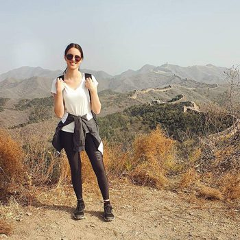 Alexia trekking on the Great Wall of China