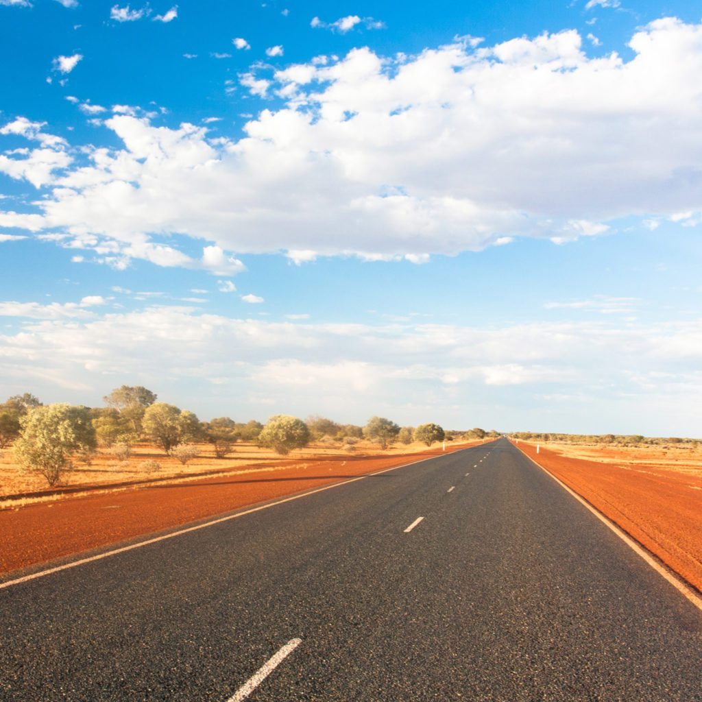 Open road in the middle of the dusty Australian Outback