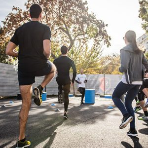 Group of people jogging up and down on the spot