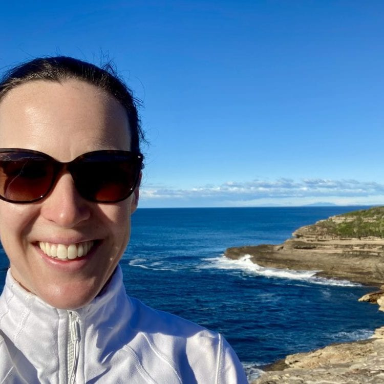 Dr Paula Conroy - Team Doctor. Background features sunny day along coastline